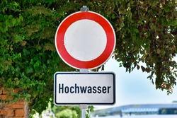 Water flood sign at German Rhine river saying 'Hochwasser', meaning 'water flood'