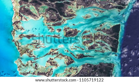 Water flow structures on Bahamas in Caribbean sea from above, natural background texture, aerial view, high resolution satellite picture, contains modified Copernicus Sentinel data [2018]