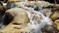 Water flowing across the rocks at Jamaica's Dunn's River Falls