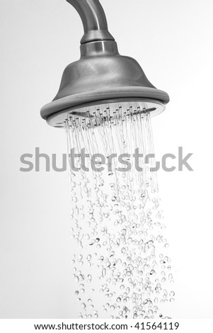 Water flowing in a old metal shower - swallow DOF.focus on top.some water drops are blurry due to water speed.