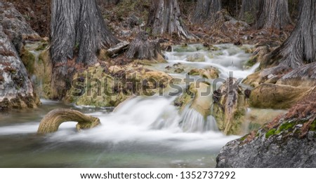 Water flowing in a stream #1352737292