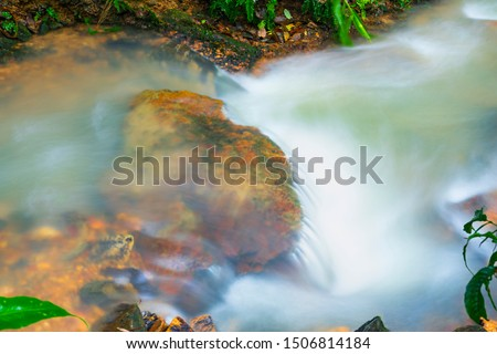 Water flowing in a stream during the rainy season #1506814184