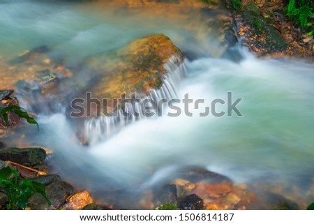 Water flowing in a stream during the rainy season #1506814187