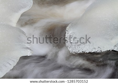 Water flowing rapidly in white water rapids