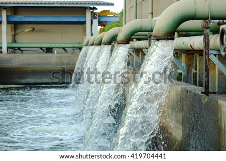 Water flows from a pipe for cooling of machine.
