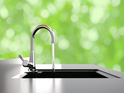 water flows from kitchen faucet to sink on green bokeh background