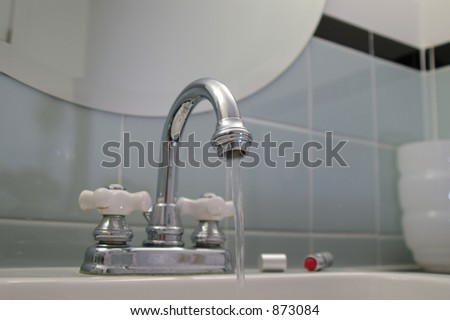Water flows from the tap in a retro restroom.