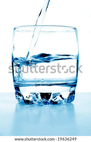 Water flows in a glass.