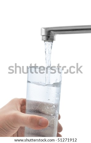 Water flows into the glass. Isolated on white.