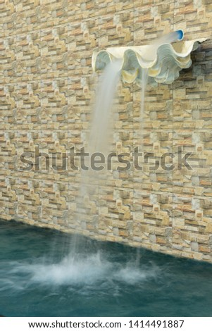 Water flows into the shells and flows through the pool. #1414491887