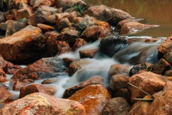 Water flows on rocks at the falls.