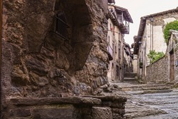Water fountain in a stone alley in a charming village called Rupit in the province of Barcelona, Catalonia, Spain.
