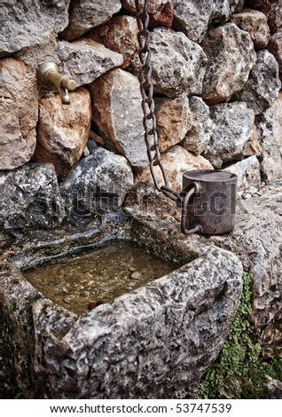 Water fountain in the mountain - stock photo