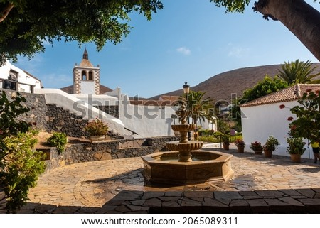 Water fountain next to the white church of Betancuria, west coast of the island of Fuerteventura, Canary Islands. Spain