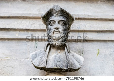 water fountain with a bust of...