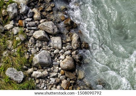 Water from a flowing stream taken from above with large stones #1508090792