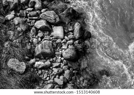 Water from a flowing stream taken from above with large stones #1513140608