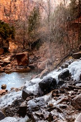 Water from freefalling water forms ice on boulders at Lower Emerald Pool in Zion National Park, Utah.