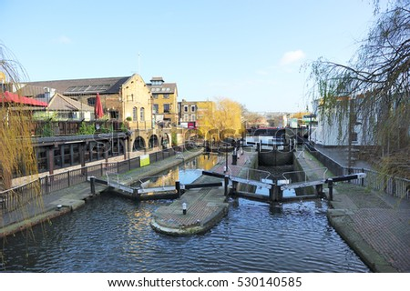 Water gate and boats in the canal in Camden town, London