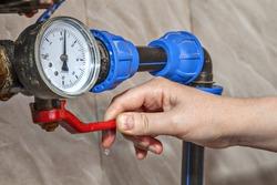 Water gauge pressure, hand shut off main valve, close-up.