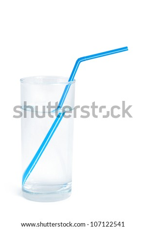 Water glass with a blue straw on white background - stock photo