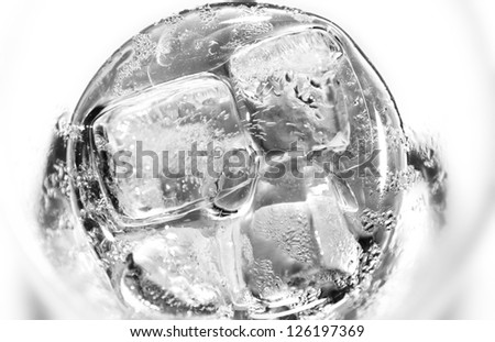 Water glass with ice cubes - stock photo