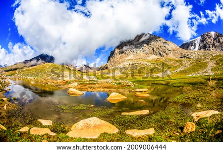 Water in a mountain valley. Mountain valley water. Mountain water