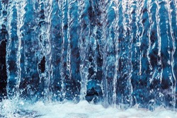 Water in motion, rough current, waterfall, high water. Transparency, crystal, strength. Blue toning, sunlight from above.