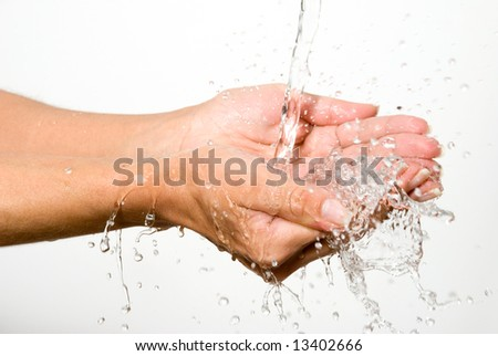 Water in palms of hands - stock photo