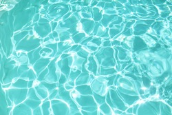 Water In Pool Texture. Turquoise Pure Aqua Surface With Ripples And Glares Pattern. Fresh Liquid With Sunlight Reflection In Summer.