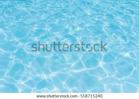 water in swimming pool rippled water detail background - Shutterstock ID 558715240