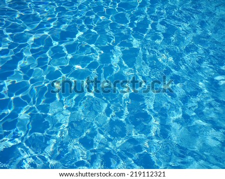 Water in the swimming pool with a wave