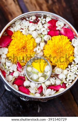Water in water dipper with colorful flowers pedestal for Songkran festival, Thailand,Vintage #391540729