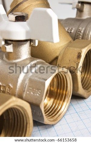 water inlet valve pump system on a background of graph paper