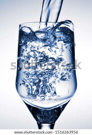 Water is being poured into a glass #1516263956