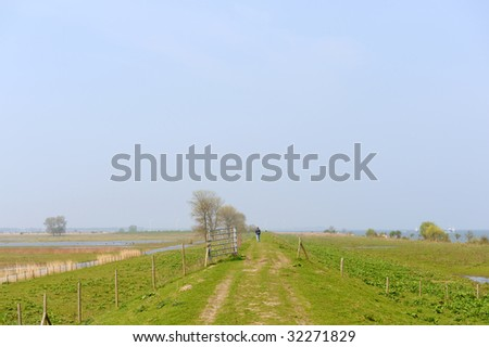 Water landscape in Holland with walking person