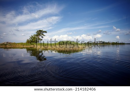 Water landscape. The lake. Beautiful landscape. Water smooth surface and the blue sky with clouds. #214182406