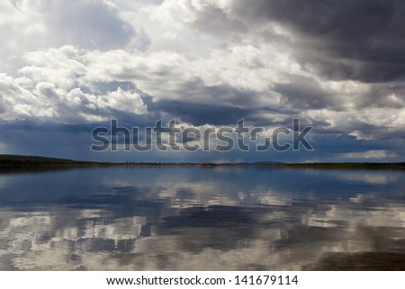 water landscape with clouds and their reflection in the water