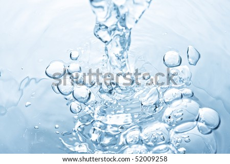 Water leaking to puddle making bubbles closeup photo