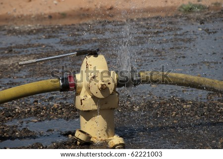 Water leaks from a fire hydrant.