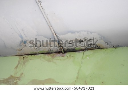 Water leaks on the ceiling causing damage, tiles and cement. #584917021
