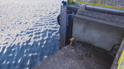 Water Level Gauge Board Scale attached to Concrete Canal Bank in Harbor Wharf