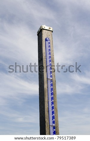 Water level gauge in natural area in the Netherlands. Natural landscape where water can rise as high as 11 meters when flooded.