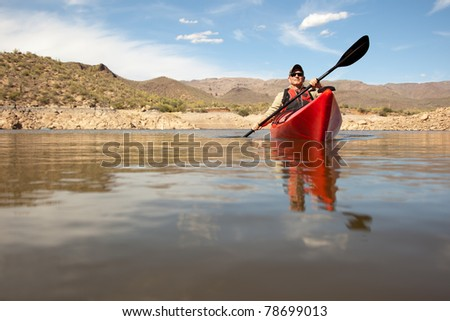 Water Level View of Man Kayaking