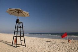 Water lifeguard stand with umbrella