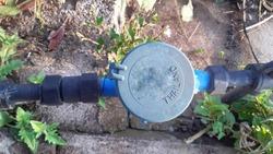 Water meter,black pipe on concrete floor.