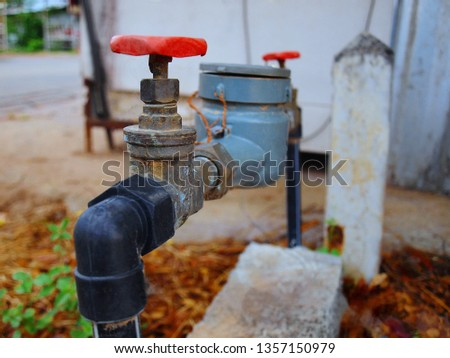 Water meters and valves: installed on a cement basis for measuring the amount of water flowing through the volume calculation device and sending values to the top dial.