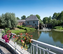 water mill moulin de Grand Fayt in northern france under blue sky in summer