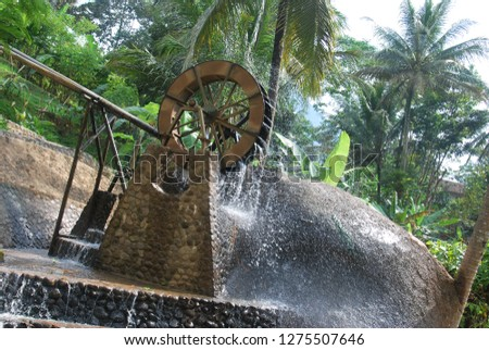 water mill powered by river stream