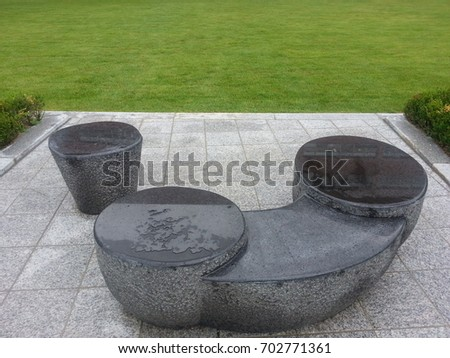 Water on stone bench  #702771361